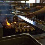 ribs-cooking-at-ribs-and-burgers